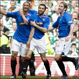 Daniel Cousin (left) is congratulated by Brahim Hemdani and Kirk Broadfoot after giving Rangers a 2-1 lead.