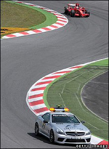 The safety car leads the cars