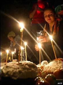 Bishkek churchgoers look at eggs and cakes