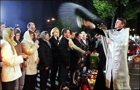 Priest blesses cakes outside Kiev's St Vladimir's Cathedral