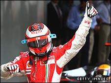 Kimi Raikkonen celebrates his Spanish Grand Prix victory with Lewis Hamilton visible in the background