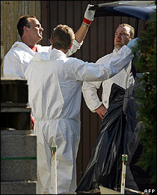 Police secure evidence in the backyard of the suspect's house in Amstetten