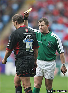 Nick Lloyd of Saracens is shown the yellow card by referee Nigel Owens