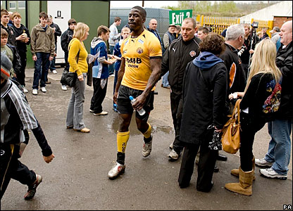Dwain Chambers wanders through the fans before the match