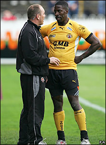 Dwain Chambers gets his instructions from coach Colin Maskill