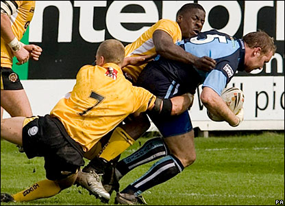 Dwain Chambers helps make a tackle