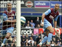 Gabriel Agbonlahor (left) watches as John Carew (right) heads Villa level