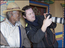 BBC cameraman showing camera to Tibetan man