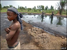 A boy by an abandoned oil well in Nigeria