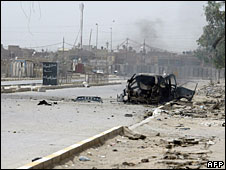 A vehicle hit during fighting in Sadr City, 27 April 2008