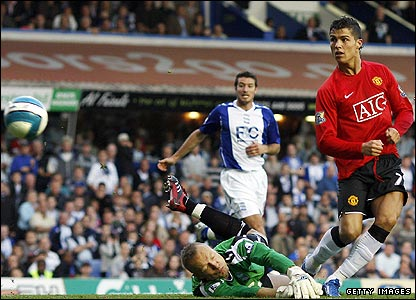 Cristiano Ronaldo watches as his shot beats Birmingham keeper Maik Taylor