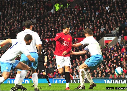 Cristiano Ronaldo (centre) scores with a cheeky backheel during United's victory against Aston Villa