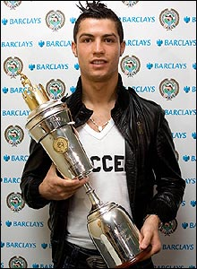 Cristiano Ronaldo holds his trophy after being named as the Professional Footballers' Association player of the year