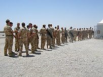 Troops queue for lunch at the mess tent