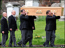 The coffin being carried into the church