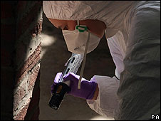 An investigator examines on of the four cellars