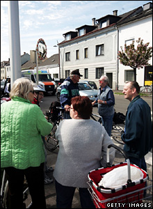 Local residents discuss the events in Amstetten