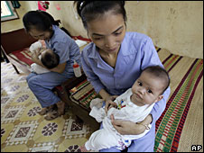 Baby girls in an orphanage near Hanoi, Vietnam, 23 April 2008