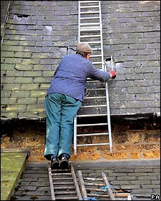 A man repairing a roof