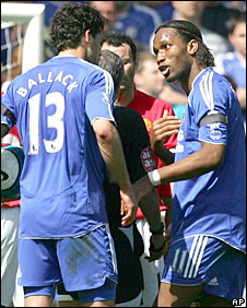 Michael Ballack and Didier Drogba argue about who is going to take a free-kick