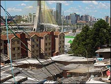 Favela with the high-rise city skyline in the background