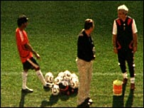 Player and coach during World Cup training