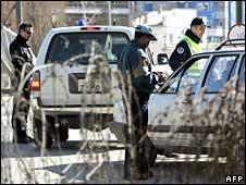 Kosovo and UN mission in Kosovo (UNMIK) police patrol