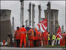 Striking workers stand outside the Grangemouth oil refinery in Scotland