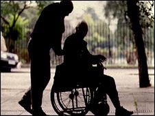 Anonymous elderly man in wheelchair