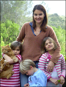 Helena Frith Powell and her children in the garden of their home in France
