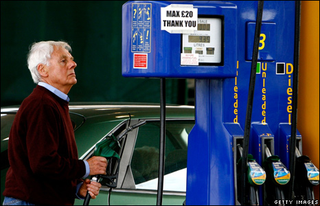 Motorist filling up with petrol