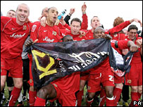 Milton Keynes Dons celebrate after winning promotion
