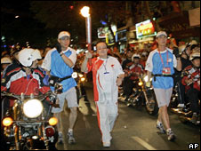 Torch bearer runs through the streets of Ho Chi Minh City