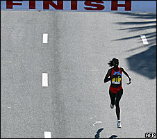 Ethiopian runner Birhane Adere reaches the finish line during the Dubai Marathon 2008