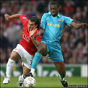 Tevez tries to get past Toure