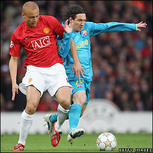 Wes Brown contests possession with Messi