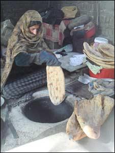 Qamair Gul bakes bread