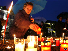 Residents of Amstetten, Austria, hold a vigil for the family of Josef Fritzl