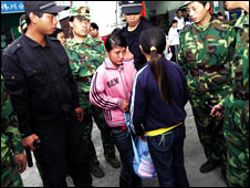 Girl talks to be police after being rescued from a factory in Guangdong