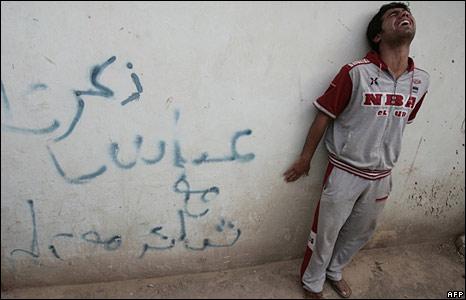 Man grieving outside hospital in Baghdad