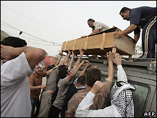 Coffin is lifted onto minivan outside Sadr City hospital in Baghdad - 30/4/2008