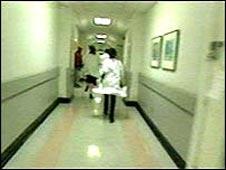 Junior doctors rushing down corridor