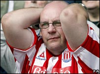 A Stoke fan watching his team