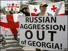 Protesters hold Georgian flags and an anti-Russian posters outside the Russian Embassy in Tbilisi. File photo