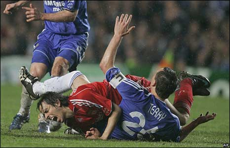 Liverpool's Yossi Benayoun (left) and Chelsea John Terry collide