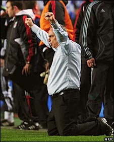 Avram Grant falls to his knees after the final whistle at Stamford Bridge