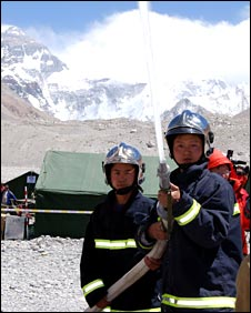 Firemen demonstrate their equipment at base camp