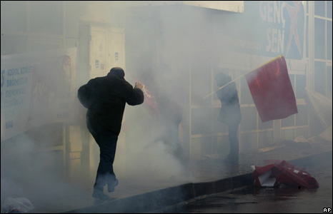 Man running from tear gas, Istanbul, Turkey