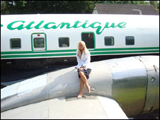 Tricia Sott sitting on the plane's wing