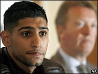 Amir Khan pictured with promoter Frank Warren in the background